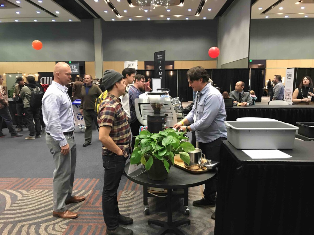 Us coffeechamps qualifying event in reno sends lots of talent veteran barista competitor mike marquard far right of blueprint coffee in st louis served coffee at the barista guild bar malvernweather Image collections