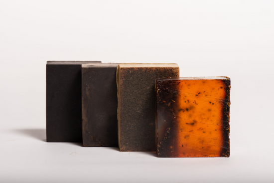 These are multiple soap bars from the product line made of coffee. They are all varying colors of dark and light brown.